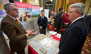 State capitol turns cardinal and gold to showcase Iowa State research