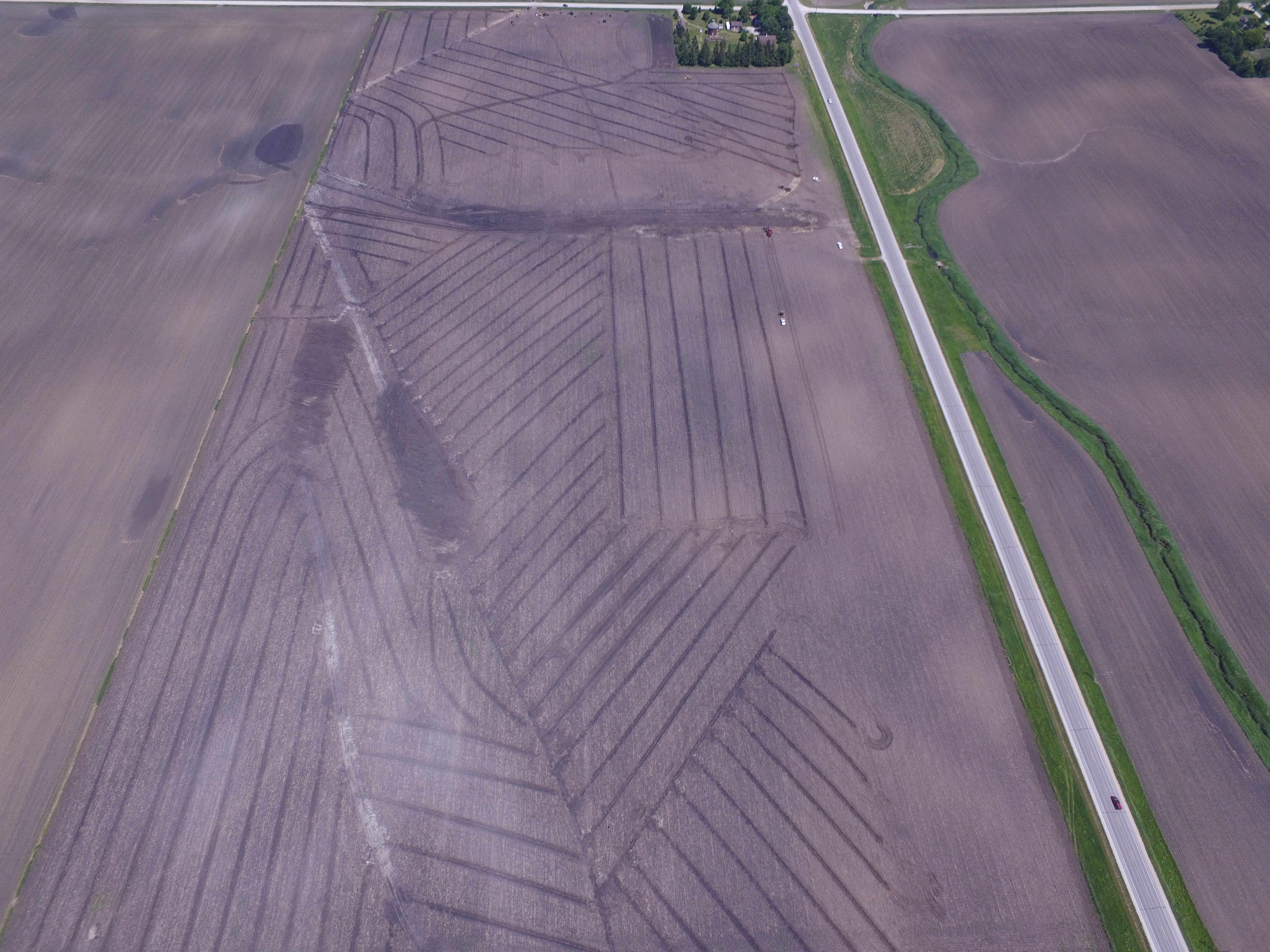 This photo shows the amount of drainage infrastructure that might exist under a typical farm field. Drainage keeps soils dry enough for farmers to cultivate crops in soil that might be too wet otherwise. Image courtesy of Michael Castellano.